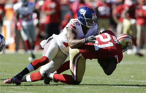 "<div class=""meta image-caption""><div class=""origin-logo origin-image ""><span></span></div><span class=""caption-text"">New York Giants defensive end Osi Umenyiora (72) tackles San Francisco 49ers running back Frank Gore (21) during the second quarter of an NFL football game in San Francisco, Sunday, Oct. 14, 2012. (AP Photo/Marcio Jose Sanchez) (AP Photo/ Marcio Jose Sanchez)</span></div>"