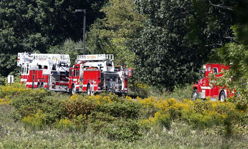 Firetrucks are lined-up not far from the site of a helicopter crash Saturday, Sept. 15, 2012, in West Windsor, N.J. West Windsor police Lt. Robert Garofolo said that witnesses reported to police that the helicopter struck a flock of birds shortly before crashing in a corn field. &#40;AP Photo&#47;Mel Evans&#41; <span class=meta>(AP Photo&#47; Mel Evans)</span>