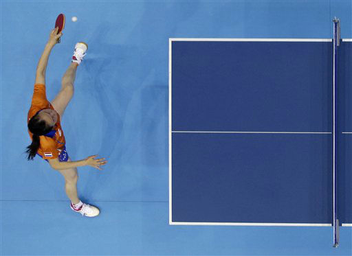 Jiao Li of the Netherlands competes against Li Xiaoxia of China during the women&#39;s singles table tennis competition at the 2012 Summer Olympics, Tuesday, July 31, 2012, in London. &#40;AP Photo&#47;Sergei Grits&#41; <span class=meta>(AP Photo&#47; Sergei Grits)</span>