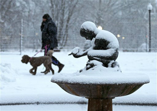 "<div class=""meta image-caption""><div class=""origin-logo origin-image ""><span></span></div><span class=""caption-text"">A man walks his dog past the snow covered ""Boy and Bird"" fountain in the Boston Public Garden in Boston, Friday, Feb. 8, 2013. Mass. Gov. Deval Patrick declared a state of emergency Friday and banned travel on roads as of 4 p.m. as a blizzard that could bring nearly 3 feet of snow to the region began to intensify. As the storm gains strength, it will bring ""extremely dangerous conditions"" with bands of snow dropping up to 2 to 3 inches per hour at the height of the blizzard, Patrick said. (AP Photo/Charles Krupa) (AP Photo/ Charles Krupa)</span></div>"