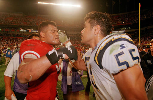 San Diego Chargers&#39; Junior Seau &#40;55&#41;, right, congratulates San Francisco Giants&#39; Ken Norton, Jr., &#40;51&#41;, who played the last two seasons with the Dallas Cowboys, on his third consecutive Super Bowl victory, Jan. 29, 1995 at Miami&#39;s Joe Robbie Stadium.  The 49ers beat the Chargers, 49-26 in Super Bowl XXIX. &#40;AP Photo&#47;David Longstreath&#41; <span class=meta>(AP Photo&#47; David Longstreath)</span>