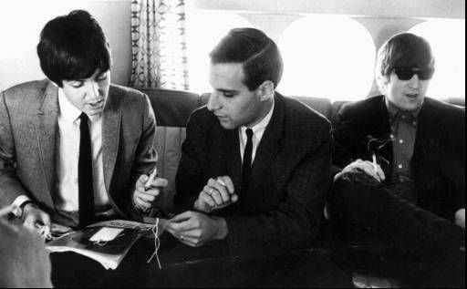 "<div class=""meta ""><span class=""caption-text "">Larry Kane, center, is pictured with the Beatles Paul McCartney, left, and John Lennon in this undated photo. When Kane, who was then a news director at a Miami radio station, wrote to Beatles manager Brian Epstein to request an interview with the group in 1964, he ended up with an invitation to join John, Paul, George and Ringo on their 26-city, 31-day U.S. tour. (AP Photo) (AP Photo/ Anonymous)</span></div>"