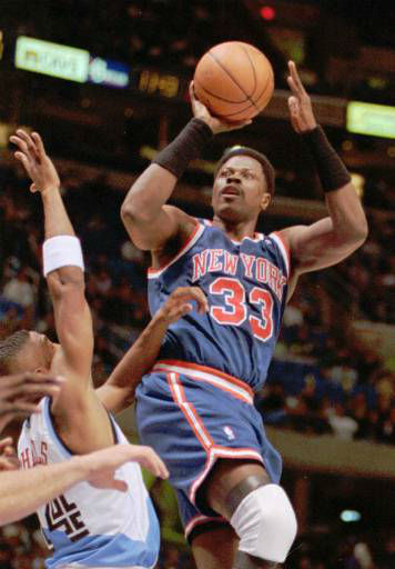 New York Knicks center Patrick Ewing &#40;33&#41; shoots over Michael Cage of the Cleveland Cavaliers during the Knicks&#39; 94-84 win Wednesday, Nov. 22, 1995, in Cleveland.  When he had to be, Ewing was perfect.  Ewing scored 12 fourth-quarter points making every shot he took in the period, as the  Knicks pulled away and beat the stubborn Cleveland Cavaliers  their fourth straight victory. &#40;AP Photo&#47;Mark Duncan&#41; <span class=meta>(AP Photo&#47; MARK DUNCAN)</span>