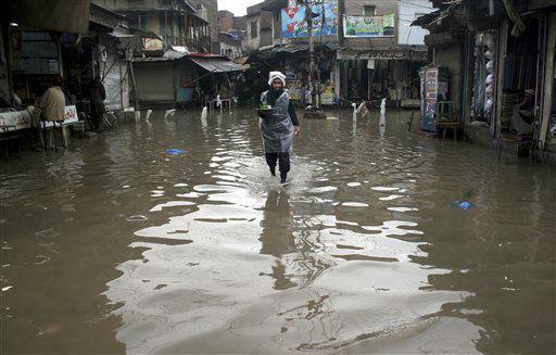 A Pakistani man walks through a flooded street on a rainy day in Peshawar, Pakistan, Monday, Feb. 4, 2013. &#40;AP Photo&#47;Mohammad Sajjad&#41; <span class=meta>(AP Photo&#47; Mohammad Sajjad)</span>