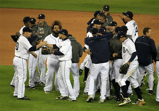 The Detroit Tigers celebrate after winning Game 4 of the American League championship series 8-1, against the New York Yankees, Thursday, Oct. 18, 2012, in Detroit. The Tigers move on to the World Series. &#40;AP Photo&#47;Carlos Osorio&#41; <span class=meta>(AP Photo&#47; Carlos Osorio)</span>