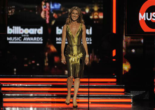"<div class=""meta ""><span class=""caption-text "">Celine Dion presents the award for Billboard artist of the year at the Billboard Music Awards at the MGM Grand Garden Arena on Sunday, May 19, 2013 in Las Vegas. (Photo by Chris Pizzello/Invision/AP) (AP Photo/ Chris Pizzello)</span></div>"
