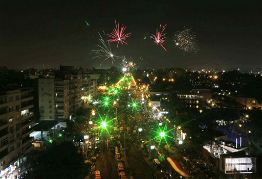 "<div class=""meta ""><span class=""caption-text "">Fireworks light the sky as opponents of Egypt's Islamist President Mohammed Morsi protest outside the presidential palace, in Cairo, Egypt, Tuesday, July 2, 2013.  With the clock ticking, Egypt's besieged president said Tuesday that he will not step down as state media reported that the powerful military plans to overturn his Islamist-dominated government if the elected leader doesn't meet the demands of the millions of protesters calling for his ouster.(AP Photo/Hassan Ammar) (AP Photo/ Hassan Ammar)</span></div>"