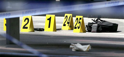 Evidence lays on the street near the Empire State Building following a shooting, Friday, Aug. 24, 2012, in New York. New York City Mayor Michael Bloomberg said some of the victims may have been hit by police bullets as police and the gunman exchanged fire. Police say a recently laid-off worker shot a former colleague to death near the iconic skyscraper and then randomly opened fired on people nearby before firing on police. &#40;AP Photo&#47;Julio Cortez&#41; <span class=meta>(AP Photo&#47; Julio Cortez)</span>