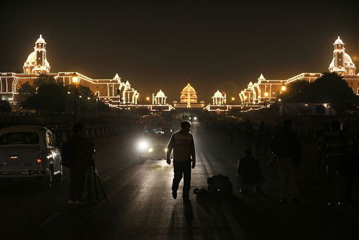 An Indian man walks on a road leading to an illuminated Raisina hill, which houses India&#39;s most important ministries and presidential palace, after the Beating Retreat ceremony, in New Delhi, India, Tuesday, Jan. 29, 2013. The ceremony is held annually on Jan. 29, which marks the end of republic day celebrations. &#40;AP Photo&#47;Manish Swarup&#41; <span class=meta>(AP Photo&#47; Manish Swarup)</span>