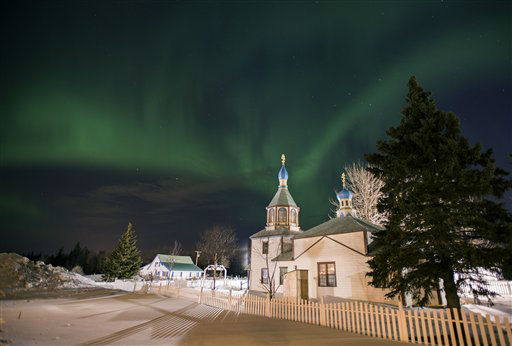 The aurora borealis, or northern lights, fill the sky early Sunday, March 17, 2013, above the Holy Assumption of the Virgin Mary Russian Orthodox church in Kenai, Alaska. The bright display at times filled the sky. &#40;AP Photo&#47;M. Scott Moon&#41; <span class=meta>(AP Photo&#47; M. SCOTT MOON)</span>