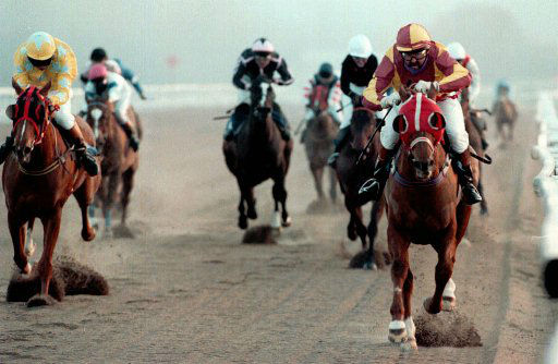 Davy Jones, 50, right, on his way to winning the Ontario Amateur Riders&#39; Handicap on Digpast, a 100-30 shot, at Lingfield, 30 miles &#40;50 kms&#41; south of London, Thursday Feb 1, 1996.  Jones is a former member of the Monkees pop group and it was his first winning ride. The horse was a 50th birthday present from his daughter Sarah. &#40;AP Photo&#47; Adam Butler&#41; UK OUT <span class=meta>(AP Photo&#47; ADAM BUTLER)</span>