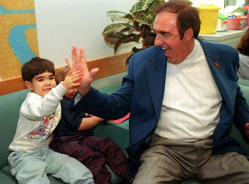 FILE--Entertainer Jim Nabors, right, offer a high five to liver transplant patient Devin Otsuka, 4, of San Diego, in this Feb. 15, 1996, file photo. Jim Nabors is ready to hit the stage again after being hospitalized earlier this summer for a minor stroke, said an assistant to the 69-year-old.  &#40;AP Photo&#47;Kevork Djansezian, File&#41; <span class=meta>(AP Photo&#47; KEVORK DJANSEZIAN)</span>