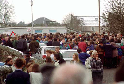 A crowd gathers outside the elementary school in Dunblane, Scotland, where an unidentified gunman opened fire killing thirteen children and a teacher Wednesday, Mar. 13, 1996. The gunman shot and killed himself following the shootings. &#40;AP Photo&#47;Louis Flood&#41; <span class=meta>(AP Photo&#47; LOUIS FLOOD)</span>