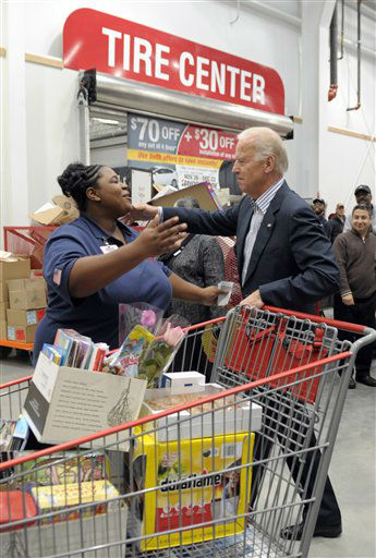 Vice President Joe Biden goes to hug Costco employee Ivey Stewart, left, after shopping at the a Costco store in Washington, Thursday, Nov. 29, 2012. Biden  went shopping for presents and to highlight the importance of renewing middle-class tax cuts so families and businesses have more certainty at this critical time for our economy. &#40;AP Photo&#47;Susan Walsh&#41; <span class=meta>(AP Photo&#47; Susan Walsh)</span>