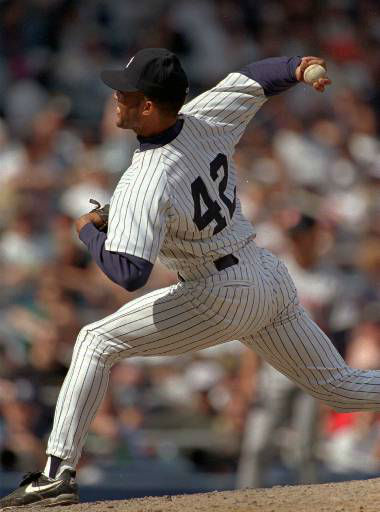 New York Yankees relief pitcher Mariano Rivera throws a pitch during the sixth inning of Sunday&#39;s 6-3 victory over the Minnesota Twins, Sunday, April 28, 1996, at New York&#39;s Yankees Stadium. Rivera pitched three hitless innings  1996.&#40;AP Photo&#47;Kathy Willens&#41; <span class=meta>(AP Photo&#47; KATHY WILLENS)</span>