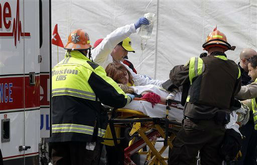 "<div class=""meta ""><span class=""caption-text "">An injured person is loaded into an ambulance in the aftermath of two blasts which exploded near the finish line of the Boston Marathon in Boston Monday, April 15, 2013. Two bombs exploded near the finish line of the Boston Marathon on Monday, killing two people, injuring 23 others and sending authorities rushing to aid wounded spectators. A senior U.S. intelligence official said two other explosive devices were found nearby.  (AP Photo/Elise Amendola) (AP Photo/ Elise Amendola)</span></div>"