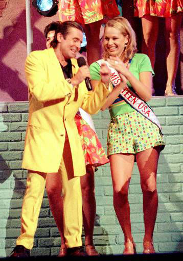 Davy Jones, of the &#39;60s megagroup, The Monkees, serenades Miss Teen USA 1995, Keylee Sanders, during the performance portion of the 1996 Miss Teen USA Pageant, Monday, Aug. 19, 1996 in Las Cruces, N.M.  The Monkees, currently on their 30th anniversary tour, will be the featured artists on the Miss Teen USA Pageant, which will be telecast live from Las Cruces, N.M., on Wednesday, Aug. 21, 1996 at 9:00p.m. ET&#47;PT on the CBS Television Network. &#40;AP Photo&#47;Miss Universe, ho&#41; <span class=meta>(AP Photo&#47; Anonymous)</span>