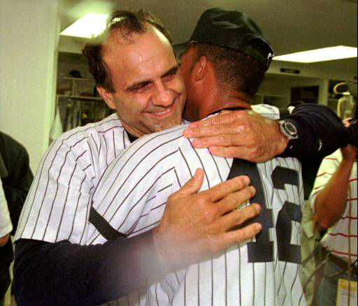 New York Yankees manager Joe Torre, left, hugs Mariano Rivera in the locker room after the Yankees swept the Milwaukee Brewers 19-2, 6-2, to clinch the AL East Division title Wednesday, Sept. 25, 1996, at Yankee Stadium in New York.  &#40;AP Photo&#47;John Dunn&#41; <span class=meta>(AP Photo&#47; JOHN DUNN)</span>