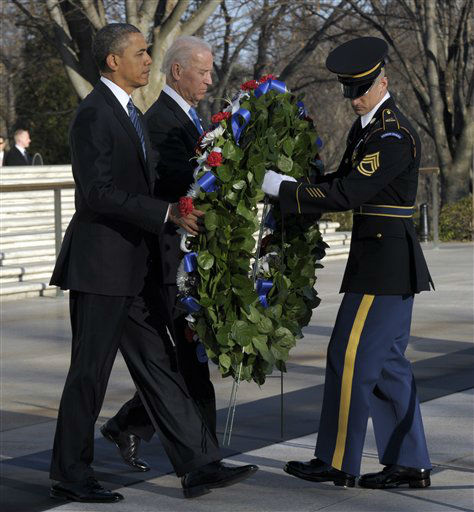 President Barack Obama and Vice President Joe Biden place a wreath at the Tomb of the Unknowns at Arlington National Cemetery in Arlington, Va., Sunday, Jan. 20, 2013.  &#40;AP Photo&#47;Susan Walsh&#41; <span class=meta>(AP Photo&#47; Susan Walsh)</span>