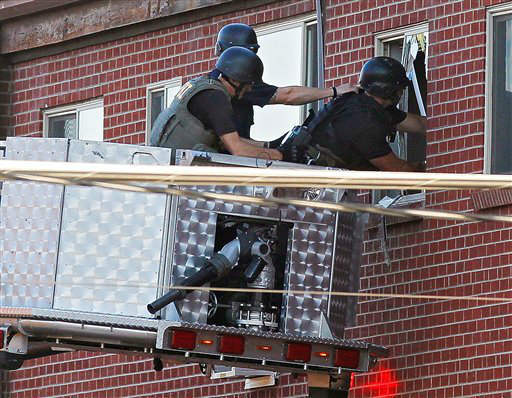 Police use a video camera to look inside an apartment  where the suspect in a shooting at a movie theatre lived in Aurora, Colo., Friday, July 20, 2012. As many as 12 people were killed and 50 injured at a shooting at the Century 16 movie theatre early Friday during the showing of the latest Batman movie. &#40;AP Photo&#47;Ed Andrieski&#41; <span class=meta>(AP Photo&#47; Ed Andrieski)</span>