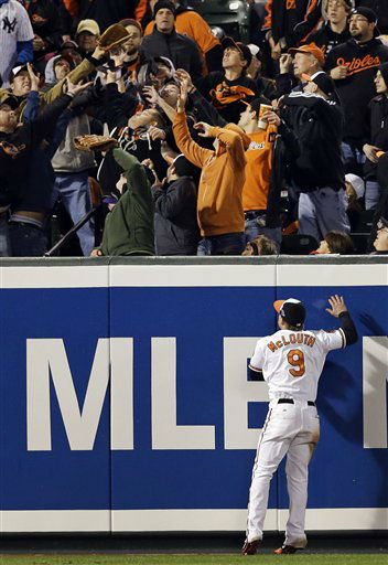 Baltimore Orioles left fielder Nate McLouth watches fans reach for a solo home run ball hit by New York Yankees&#39; Russell Martin in the ninth inning of Game 1 of the American League division baseball series on Sunday, Oct. 7, 2012, in Baltimore. New York won 7-2. &#40;AP Photo&#47;Patrick Semansky&#41; <span class=meta>(AP Photo&#47; Patrick Semansky)</span>