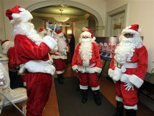 "<div class=""meta ""><span class=""caption-text "">Volunteers of America Santas pose for photos before their the 110th annual Sidewalk Santa Parade, in New York,  Friday, Nov. 23, 2012. The donations they raise are used for a holiday food voucher program for needy residents. (AP Photo/Richard Drew) (AP Photo/ Richard Drew)</span></div>"