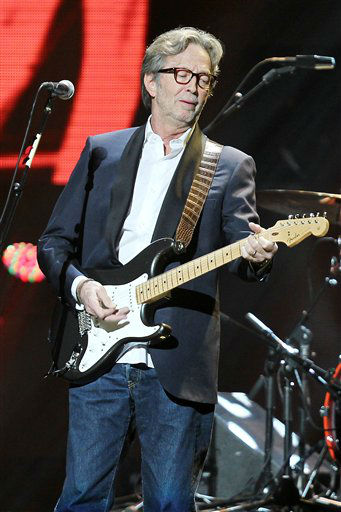 "<div class=""meta image-caption""><div class=""origin-logo origin-image ""><span></span></div><span class=""caption-text"">This image released by Starpix shows Eric Clapton performing at the 12-12-12 The Concert for Sandy Relief at Madison Square Garden in New York on Wednesday, Dec. 12, 2012. Proceeds from the show will be distributed through the Robin Hood Foundation. (AP Photo/Starpix, Dave Allocca) (AP Photo/ Dave Allocca)</span></div>"