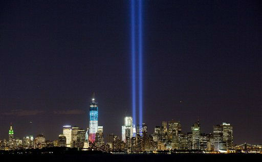 "<div class=""meta ""><span class=""caption-text "">The Tribute in Light shines above the World Trade Center and the Statue of Liberty, left of center, Monday, Sept. 10, 2012 as seen from Bayonne, N.J. Tuesday will mark the eleventh anniversary of the terrorist attacks of Sept. 11, 2001.  The tallest tower is 1 World Trade Center, now up to 105 floors. In the center is 4 World Trade Center. The Empire State Building is left, and the Brooklyn Bridge is right. (AP Photo/Mark Lennihan) (AP Photo/ Mark Lennihan)</span></div>"