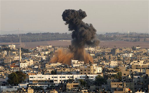 "<div class=""meta image-caption""><div class=""origin-logo origin-image ""><span></span></div><span class=""caption-text"">Smoke rises following an Israeli attack on Gaza City, Thursday, Nov. 15, 2012. Israel barraged the Gaza Strip with airstrikes and shelling Wednesday and killed the Hamas military chief in a targeted strike, launching a campaign aimed at stopping rocket attacks from Islamic militants. The assault killed 10 other Palestinians, including two children and seven militants. On Thursday, militant rockets fired into Israel killed three Israelis, raising the likelihood of a further escalation. (AP Photo/Hatem Moussa) (AP Photo/ Hatem Moussa)</span></div>"