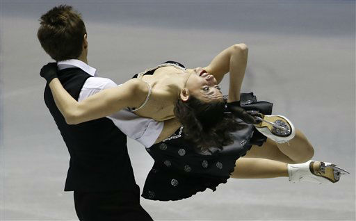 Ksenia Monko and Kirill Khaliavin of Russia perform during the Ice Dance Short Dance of the ISU World Team Trophy in Figure Skating in Tokyo, Thursday, April 11, 2013. (AP Photo/Koji Sasahara)