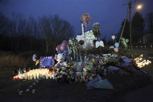 "<div class=""meta ""><span class=""caption-text "">Candles, balloons, stuffed animals and personal notes are placed on a memorial for the victims of the Sandy Hook Elementary School shooting, Sunday, Dec. 16, 2012, in the Sandy Hook village of Newtown, Conn. A gunman walked into Sandy Hook Elementary School in Newtown Friday and opened fire, killing 26 people, including 20 children. (AP Photo/Mary Altaffer) (AP Photo/ Mary Altaffer)</span></div>"
