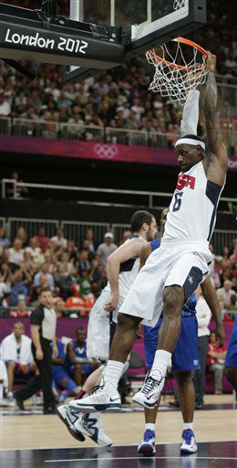 USA&#39;s Lebron James hangs on the rim following a dunk during the first half of a preliminary men&#39;s basketball game against France at the 2012 Summer Olympics, Sunday, July 29, 2012, in London. &#40;AP Photo&#47;Charles Krupa&#41; <span class=meta>(AP Photo&#47; Charles Krupa)</span>