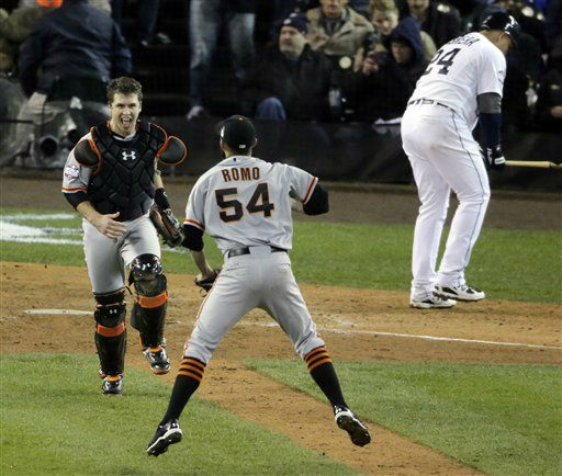 San Francisco Giants catcher Buster Posey and San Francisco Giants relief pitcher Sergio Romo &#40;54&#41; celebrate after striking out Detroit Tigers third baseman Miguel Cabrera &#40;24&#41; to win Game 4 of baseball&#39;s World Series Sunday, Oct. 28, 2012, in Detroit. The Giants won 4-3. &#40;AP Photo&#47;Charlie Riedel&#41; <span class=meta>(AP Photo&#47; Charlie Riedel)</span>