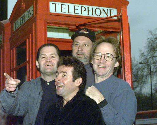 Members of the pop group The Monkees pose in front of a telephone booth in London  Friday, January 10, 1997 following a press conference at the Hard Rock Cafe where they announced plans for all four members of the group  to begin touring for the first time in 30 years.  From left to right are Mickey Dolenz, Davy Jones, Mike Nesmith and Peter Tork.  &#40;AP Photo&#47;Lynne Sladky&#41; <span class=meta>(AP Photo&#47; LYNNE SLADKY)</span>