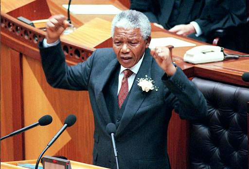 South African President Nelson Mandela gestures during his state of the nation address at the opening of Parliament in Cape Town Friday February 7th, 1997. &#40;AP Photo&#47;Anna Zieminski&#47;POOL&#41; <span class=meta>(AP Photo&#47; ANNA ZIEMINSKI)</span>
