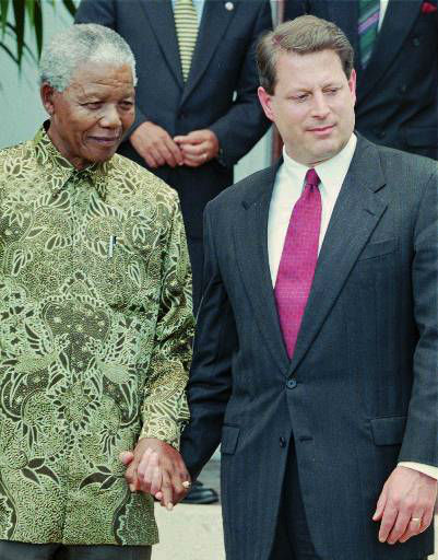 South African President Nelson Mandela, left, and U.S. Vice President Al Gore hold hands after meeting in Cape Town Sunday February 16, 1997. Gore is on a four-day visit to South Africa. &#40;AP Photo &#47; Sasa Kralj&#41; <span class=meta>(AP Photo&#47; SASA KRALJ)</span>