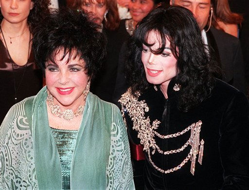 "<div class=""meta ""><span class=""caption-text "">FILE - In this Feb. 16, 1998 file photo, actress Elizabeth Taylor arrives with pop singer Michael Jackson at the Pantages Theater in the Hollywood area of Los Angeles for a birthday celebration for Taylor. (AP Photo/Chris Pizzello, file) (AP Photo/ CHRIS PIZZELLO)</span></div>"