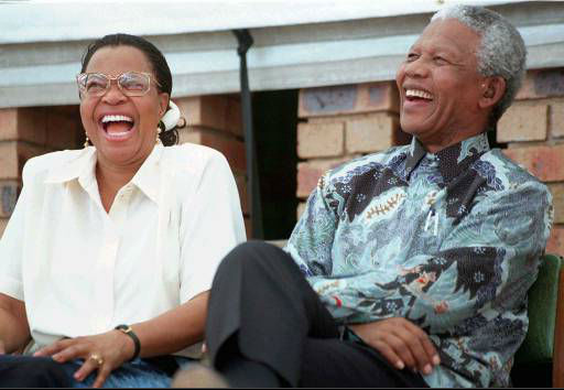 Graca Machel, left, girlfriend of South African President Nelson Mandela, right, share a lighter moment during a &#34;culture of learning&#34; campaign function in Soweto Thursday Feb. 20, 1997. Winnie Madikizela-Mandela, Mandela&#39;s former wife,   Winnie Madikizela-Mandela,  attended the same function. It was the first time all three have been seen together. &#40;AP Photo &#47; Henner Frankenfeld&#41; <span class=meta>(AP Photo&#47; HENNER FRANKENFELD)</span>