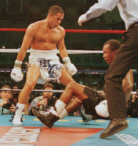 Hector Camacho, of Puerto Rico, watches as &#34;Sugar&#34; Ray Leonard falls to the ground during action in the fifth round of their fight  Saturday, March 1, 1997 in Atlantic City, N.J. Camacho won in a fifth round technical knockout. &#40;AP Photo&#47;Charles Rex Arbogast&#41; <span class=meta>(AP Photo&#47; CHARLES REX ARBOGAST)</span>