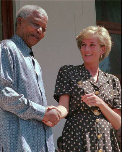 South African President Nelson Mandela, left, shakes hands with Princess Diana in Cape Town, Monday, March 17 1997.  Princess Diana met with Mandela to discuss the threat of AIDS in South Africa. &#40;AP PHOTO&#47;Sasa Kralj&#41; <span class=meta>(AP Photo&#47; SASA KRALJ)</span>