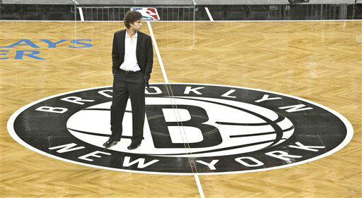 Brooklyn Nets basketball player Brook Lopez walks onto the floor of the Barclay&#39;s Center, Brooklyn&#39;s newest arena and the team&#39;s new home, after a ribbon cutting ceremony on Friday, Sept. 21, 2012 in New York. The ceremony marked the official unveiling of the arena, the first building that is part of the Atlantic Yards development in Brooklyn.  &#40;AP Photo&#47;Bebeto Matthews&#41; <span class=meta>(AP Photo&#47; Bebeto Matthews)</span>