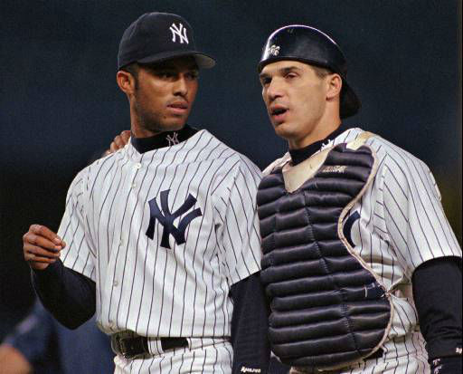 New York Yankees relief pitcher Mariano Rivera, left, talks with catcher Joe Girardi, right, after pitching his way out of a jam with the bases loaded in the ninth inning of their game against the Texas Rangers Thursday, May 8, 1997, at Yankee Stadium in New York. Rivera picked up his eleventh save of the season as the Yankees beat the Rangers 5-4. &#40;AP Photo&#47;John Dunn&#41; <span class=meta>(AP Photo&#47; JOHN DUNN)</span>