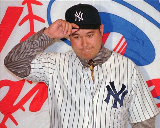 "<div class=""meta ""><span class=""caption-text "">FILE - In this May 30, 1997 file photo, New York Yankees pitcher Hideki Irabu,of Japan, dons a cap during an introductory news conference at New York's Yankee Stadium.  Irabu has been found dead at a home in a wealthy Los Angeles suburb of an apparent suicide, Los Angeles County sheriff's Sgt. Mike Arriaga said Thursday, July 28, 2011. (AP Photo/Bill Kostroun, File) (AP Photo/ BILL KOSTROUN)</span></div>"