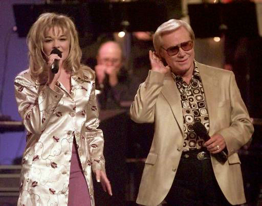 Country music veteran George Jones bends an ear toward 14-year-old newcomer LeAnn Rimes during the opening segment of the TNN-Music City News Country Awards show in Nashville, Tenn., on Monday, June 16, 1997. Jones, Rimes and Randy Travis are co-hosts of the show. &#40;AP Photo&#47;Mark Humphrey&#41; <span class=meta>(AP Photo&#47; MARK HUMPHREY)</span>