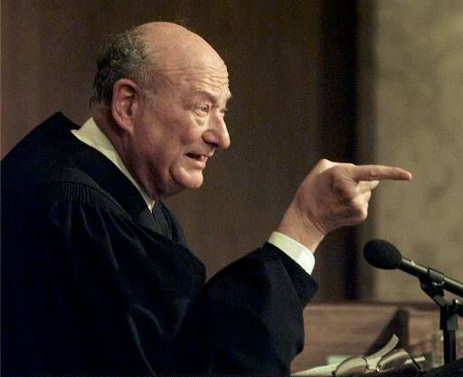 "<div class=""meta ""><span class=""caption-text "">Former New York Mayor Ed Koch, now the presiding judge on ""The People's Court,"" tapes a show at a New York studio Thursday, Aug. 21, 1997. (AP Photo/Mark Lennihan) (AP Photo/ MARK LENNIHAN)</span></div>"