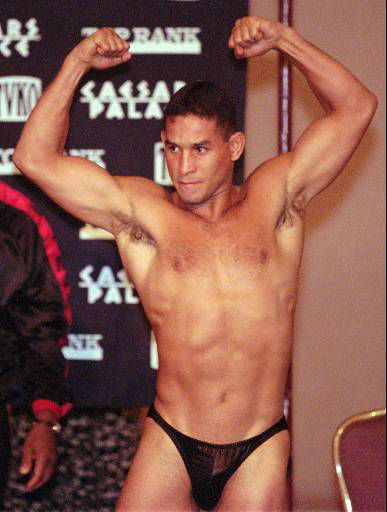 Welterweight fighter Hector Camacho flexes for the crowd prior to weighing-in at 147 pounds, Friday, Sept. 12, 1997, in Las Vegas. Camacho will fight Oscar De La Hoya for the WBC welterweight title Saturday in Las Vegas. &#40;AP Photo&#47;Jack Dempsey&#41; <span class=meta>(AP Photo&#47; JACK DEMPSEY)</span>