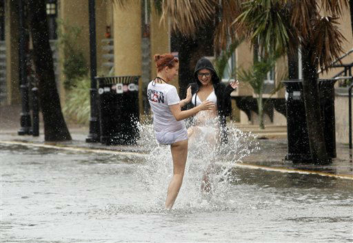 Heather Boss, right, and Brittney Lambert, both of Oklahoma, have fun in a flooded street due to heavy rains in Key West, Fla., Sunday, Aug. 26, 2012 as heavy storm winds and rain hit the northern coast. Rain bands from Tropical Storm Isaac are expected to continue streaming across Marion County Monday as the ninth named storm of the 2012 hurricane season continues toward the northern Gulf of Mexico. National Weather Service officials in Jacksonville on Sunday said Marion County began getting rain bands from Isaac around 2 p.m. and that the rain would continue through Tuesday. &#40;AP Photo&#47;Alan Diaz&#41; <span class=meta>(AP Photo&#47; Alan Diaz)</span>