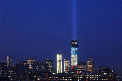 The Tribute in Light rises from behind 1 World Trade Center, now up to 105 floors, Wednesday, Sept. 12, 2012 in New York. Also under construction is 4 World Trade Center, center. &#40;AP Photo&#47;Mark Lennihan&#41; <span class=meta>(AP Photo&#47; Mark Lennihan)</span>