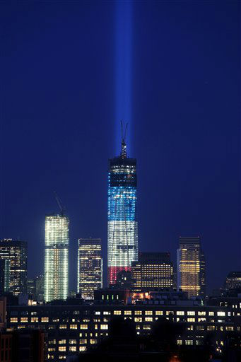 The Tribute in Light rises from behind 1 World Trade Center, now up to 105 floors, Wednesday, Sept. 12, 2012 in New York. Also under construction is 4 World Trade Center, left. &#40;AP Photo&#47;Mark Lennihan&#41; <span class=meta>(AP Photo&#47; Mark Lennihan)</span>