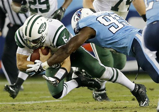 New York Jets quarterback Mark Sanchez &#40;6&#41; is brought down by Tennessee Titans defensive end Kamerion Wimbley &#40;95&#41; in the second quarter of an NFL football game, Monday, Dec. 17, 2012, in Nashville, Tenn. The Titans won 14-10. &#40;AP Photo&#47;Joe Howell&#41; <span class=meta>(AP Photo&#47; Joe Howell)</span>